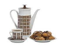 有一杯咖啡的咖啡罐和曲奇饼 免版税库存图片