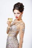 有一杯的端庄的妇女香槟。 库存照片