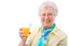有一杯的高级妇女汁液 库存照片