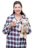 有一杯的30岁的妇女牛奶和玩具 图库摄影