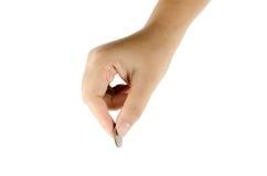 有一枚硬币的妇女的手 免版税库存图片