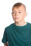 有一种时兴的发型的逗人喜爱的男孩 免版税库存照片