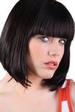有一种浮动的发型的妇女 图库摄影