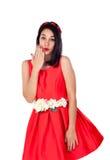 有一身典雅的红色燕尾服的可爱的深色的女孩 免版税图库摄影