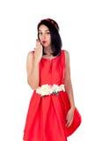 有一身典雅的红色燕尾服的可爱的深色的女孩 库存图片