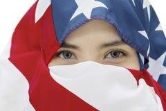 有一面美国国旗的少妇 库存照片