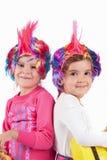 有一顶五颜六色的假发的女孩 库存照片