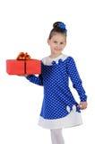 有一件礼物的小女孩在他们的手上 免版税库存照片