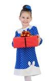 有一件礼物的小女孩在他们的手上 图库摄影