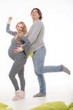 有丈夫的怀孕的时尚妇女 图库摄影