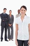 有三个工友的女实业家 免版税库存照片