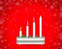 有三个灼烧的蜡烛的出现烛台 免版税库存照片