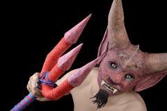 有三叉戟的恶魔 免版税库存图片