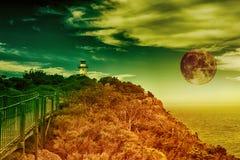有上升的月亮的灯塔 免版税库存照片