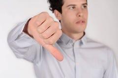有下来拇指的人 库存图片