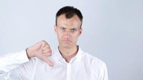 有下来拇指的失望的年轻人 免版税库存照片