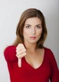 有下来拇指的妇女 库存照片