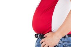 有不健康的大推出的腹部的肥胖人 免版税库存图片