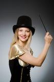有不可思议的鞭子的妇女魔术师 库存图片