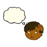 有丑恶的成长的动画片男孩在有想法泡影的头 库存图片