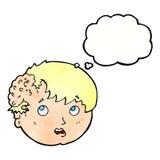 有丑恶的成长的动画片男孩在有想法泡影的头 图库摄影