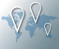 有世界地图的小组别针 免版税库存照片