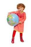 有世界地球的愉快的小孩女孩 免版税图库摄影