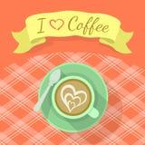 有丝带和题字的热奶咖啡杯 库存照片