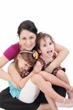 有两个孩子的愉快的母亲 库存图片