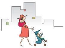 有两个小孩的现代妈妈 免版税库存图片