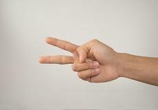 有两个手指的手,被隔绝 库存照片