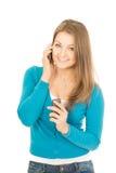 有两个电话的美丽的妇女 免版税库存照片