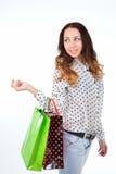 有两个购物袋的愉快的少妇 免版税库存照片