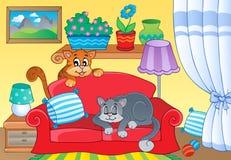 有两只猫的室在沙发 免版税图库摄影