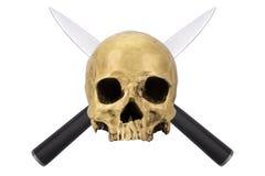 有两把横渡的刀子的头骨 免版税库存照片