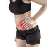 有两的妇女在显示在腹部区域的痛苦的腰围附近的棕榈 库存图片