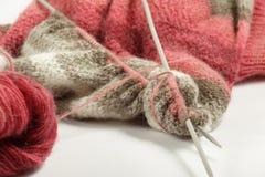 有两轮幅的被编织的毛线衣 免版税库存照片