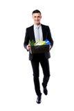 有个人财产的愉快的商人举行箱子 库存照片