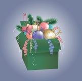 有中看不中用的物品的圣诞节绿色箱子 图库摄影