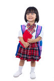 有书包和书的亚裔中国矮小的学生女孩 库存照片