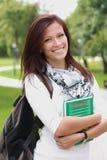 有书和袋子的大学生 免版税库存照片