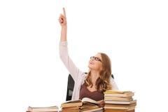 有书堆的指向的少妇  免版税库存图片