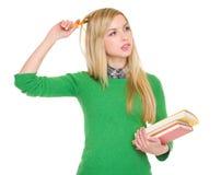 有书的关心的学员女孩 库存照片