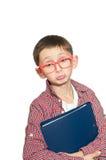 有书的哀伤的男孩 免版税图库摄影