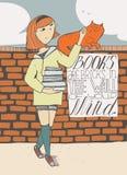 有书的女孩爱抚在砖墙上的一只猫 免版税图库摄影