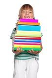 有书的小女孩 库存照片