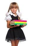 有书的小女孩 免版税图库摄影