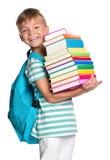 有书的小男孩 免版税图库摄影