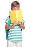 有书的小男孩 免版税库存图片