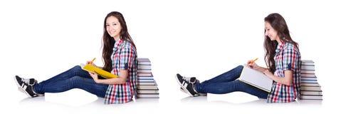 有书的年轻学生在白色 免版税图库摄影